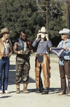 "THE A-TEAM -- ""Pros and Cons"" Episode 4 -- Pictured: (l-r) Dirk Benedict as Lt. Templeton ""Faceman"" Peck #2, Mr. T as Sgt. Bosco ""B.A."" Baracus, Unknown, George Peppard as Col. John ""Hannibal"" Smith"