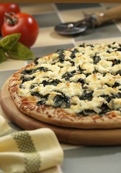 Three-Cheese and Spinach Pizza makes pizza night easier and tastier. This recipe can be ready in 30 minutes!
