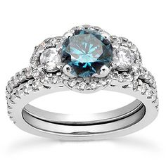 and rather affordable blue diamond engagement ring matching wedding pave band bridal set 14 karat white gold halo would like a green stone tho