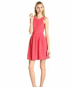 Jessica Simpson Coral Dress Absolutely stunning Jessica Simpson textured knit dress with exposed front zipper and front pockets. Shell 100% Polyester and lining 100 Polyester. Jessica Simpson Dresses Mini