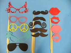 Cute idea to get snazzy and help people get creative in a photo booth, or hilarious for photos outside of the photo booth. $38 from Etsy
