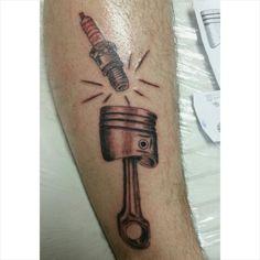 Tattoo spark plug cam shaft