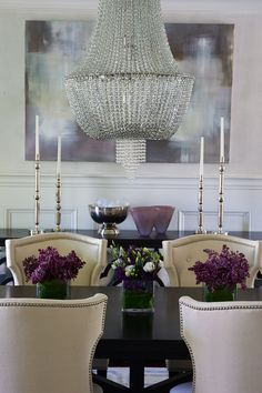 :: Havens South Designs :: what a difference an expensive looking chandelier and over sized art does for   this dining room.