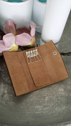 Check out this item in my Etsy shop https://www.etsy.com/listing/400312207/vegetable-tanned-leather-key-organizer