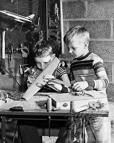 boys building a model airplane