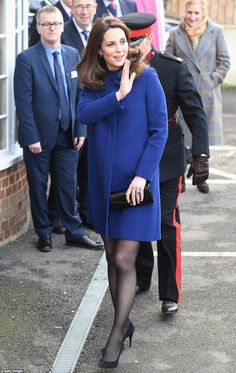 Blue for a boy? The Duchess of Cambridge opted for royal blue with her Goat coat as she touched down in Essex to open a new addiction treatment centre built by Action On Addiction on Wednesday