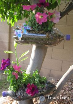 Recycled Soda Bottle Planter-Use 2 bottles. Cur the cap part off, slide them together to make planter.
