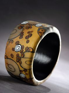 The New Nouveau by 2Roses Jewelry      A reinterpretation of Art Nouveau themes in polymer clay, gilded and all.