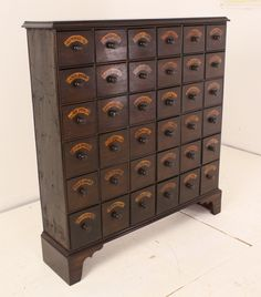 Tall Antique English Bank of Flower Seed Drawers | From a unique collection of antique and modern apothecary cabinets at http://www.1stdibs.com/furniture/storage-case-pieces/apothecary-cabinets/