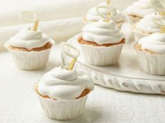 A pillowy meringue frosting and white candy halos make these super-light Angel's Food Cupcakes especially angelic.