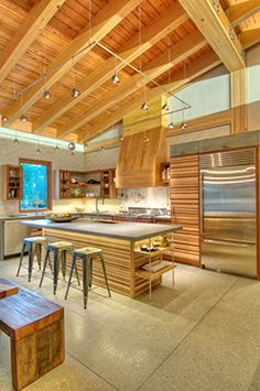 Florida Green Building - Polished concrete floors, clay walls over mold resistant drywall, and native cypress timbers used for doors, trim, cabinets and roof framing all lend to the 'Contemporary Florida Cracker' vernacular while offering stellar performance against the elements..