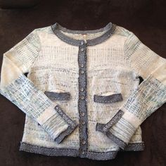 Free People Button Down Sweater Pre owned. In used condition. Free People size small sweater. In beautiful condition. Made of 61% cotton 15% acrylic 5% rayon 4 % nylon 3% wool 1% angora 11% Silk Free People Sweaters