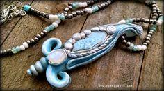 Beautiful ocean blue natural rough larimar stone with rainbow moonstone necklace. #larimar #moonstone #pendant #necklaces #handmadejewelry #atlantis #newage #blue #oceanblue #healingstones #crystals