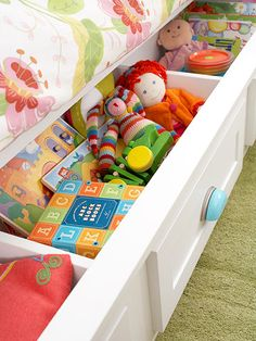 A wide underbed drawer holds toys now but can be outfitted with a mattress for sleepovers later! See more ideas here: http://www.bhg.com/decorating/storage/projects/packed-with-storage-kids-room/?socsrc=bhgpin042415uderbedstorage&page=6