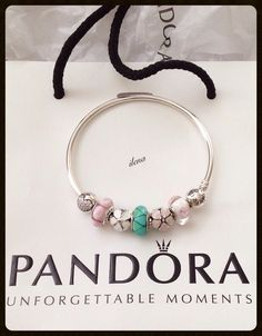 "My Pandora bangle with new ""Darling daisies clip. Ilena."