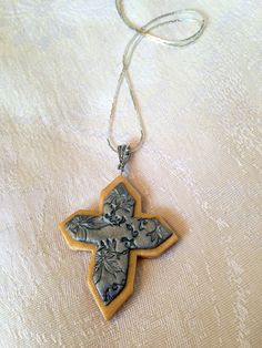 Polymer Clay Jewelry Gold and Silver Cross Necklace Pendant. $12.00, via Etsy.