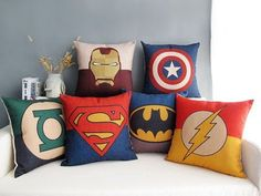 These pillows are the perfect final touch for a superhero-themed bed. | 23 Ideas For Making The Ultimate Superhero Bedroom