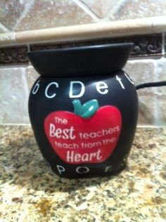 """Candle Wax Warmer: Scentsy ABCs Mid-Size Scentsy Warmer PREMIUM """"The Best Teachers Teach from the Heart"""" by Scentsy Wickless Candle Wax Warmer. $33.95. Melts Scented Waxes. Scentsy Mid-Size Candle Wax Tart Warmer. Great for Teachers or Just anyone that likes ABCs. Use this Cute Scentsy Warmer to warm and melt scentsy candle wax squares to keep your home, office, or classroom smelling good."""