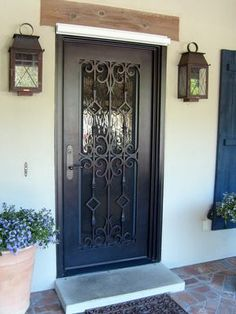 Change the face of your home with a gorgeous, custom, wrought iron door! dream home. front doors. iron doors. wrought iron door. exterior design. home remodel. home building. single door.