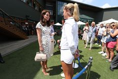 Kate Middleton Photos - Catherine, Duchess of Cambridge and Meghan, Duchess of Sussex at All England Lawn Tennis and Croquet Club on July 14, 2018 in London, England. - Day Twelve: The Championships - Wimbledon 2018