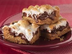 Warm Toasted Marshmallow S'more Bars  1 pouch (1 lb 1.5 oz) Betty Crocker® sugar cookie mix  1 cup graham cracker crumbs  1 cup butter or margarine, melted  3 cups milk chocolate chips (18 oz)  4 1/2 cups miniature marshmallows    Heat oven to 375°F. Bake 18 to 20 minutes.