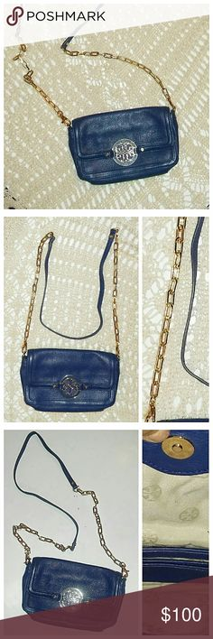 "Tory Burch Amanda Crossbody Bag Stunning pebbled leather bag in great condition. Rich royal blue with gold chain strap. The only flaw is the bottom T - the original fabric was removed exposing the underneath non leather blue (shown in pic #7). It's not visible from a distance, but it is up close. Price reflects flaw. Measures 5"" x 8"" x 1.5"". Tory Burch Bags Crossbody Bags"