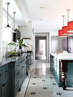 kitchen. juniper cabinets. gray v. white marble. Drum shades in persimmon and metal shades in black. penny tile.
