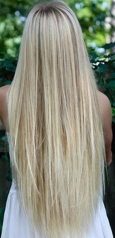 this is natural looking blonde hair. Low lights and high lights. All flowing together to soften the dark roots to light