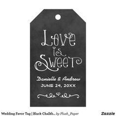 """Wedding Favor Tag   Black Chalkboard Charm Charming chalkboard cardstock favor tags feature """"Love is Sweet"""" with a custom wedding monogram in handwritten style fonts with a heart and scroll design accent that have a white chalk appearance. Background has a rustic black board textured appearance."""