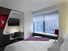 OopsnewsHotels - W New York - Downtown. Strategically located in the centre of the city, this 4-star hotel makes for an excellent base in New York City. It is located a short walk from New York Stock Exchange, the World Trade Center Site and Wall Street.   Guests can enjoy relaxing or working out in the hotel's swimming pool and fitness centre. Convenient services include an express check-in feature and a luggage storage facility.