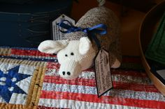 Our Patriotic Sock Pig made by Debby Clark sits on one of Suzanne Bullard's place mats!