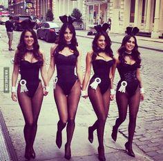 four bunnies strutting down the street