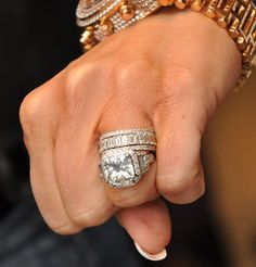 """Sheesh--I'd avoid being """"tardy for the wedding"""" out of fear!  That rock collection could leave a mark! (Kim Zolciak Engagement Ring 10 Carats & Wedding Band[s])"""