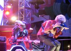 Mad T Party dormouse casually chowing down on his guitar..