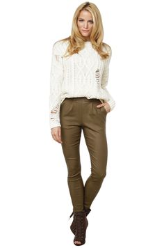 The Big Booty High Waisted Mocha Leggings feature banded waist with pleat detail along front, pockets, faux back pockets, tapered legs, and an exposed back zipper closure. Free standard U.S. shipping $75+.