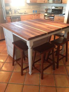 DIY - old dresser built into island complete with A DIY black walnut butcher block counter top. Via. Fantastic Husbands that can do ANYTHING!
