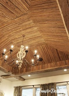 This ceiling is made with tobacco stakes!  Wood ceiling ideas from Jennifer Decorates.com