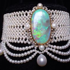 Woven seed pearl chokerwith elegant graduated pearl drapes and large antique opal brooch