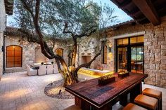 love the idea of having a private courtyard for outdoor dining and entertaining.
