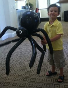 What kid doesn't like a spider balloon that is as big as he is?! This is a unique ballon twisting design that I created myself. This picture was taken in Newport Beach at a party that also had the bug guy with his show. How perfect is that? #balloon #art #orange county