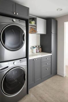 laundry room design, white laundry room with laundry room storage, laundry room organization with neutral floor tile, neutral mudroom design with laundry and folding counter and laundry sink Modern Laundry Rooms, Laundry Room Layouts, Laundry Room Remodel, Laundry Room Cabinets, Basement Laundry, Farmhouse Laundry Room, Laundry Closet, Laundry Room Organization, Diy Cabinets