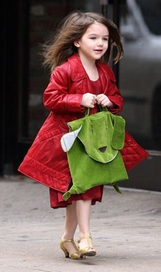 Young Fashionista Suri Cruise - I so wanna dress my little girl up like this for like Christmas or something, one day a year give her cute little heels and a fancy dress