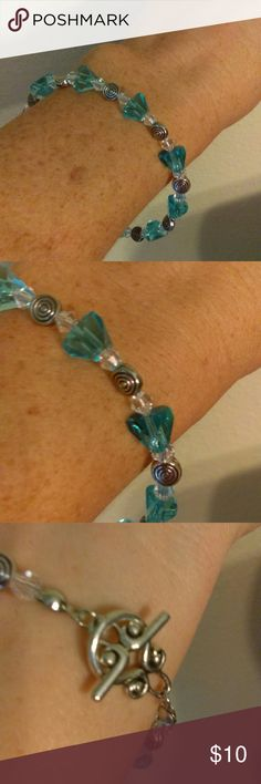 """Handmade Beaded Bracelet Turquoise & Clear Crystal Handmade Beaded Bracelet made withTurquoise & Clear Crystals and silver accents. This bracelet is 7.5"""", this is the average bracelet since. Ask about adding an extender if necessary at no extra charge. Jewelry Bracelets"""