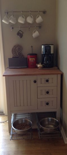 Awesome dog feeding station/coffee area/radio station... In the drawers there are coffee filters!!!!