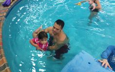 parent-tot classes at Njswim! Learning to roll to a back float!