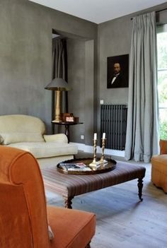 GRAY ROOM WITH BURNT ORANGE CHAIRS