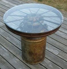 Wagon wheel milk can table, gonna be my bedside table