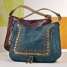 Studded Geo Border Hobo from Monroe and Main. Even if you had nothing to carry, you'd happily take this roomy, richly studded accent.