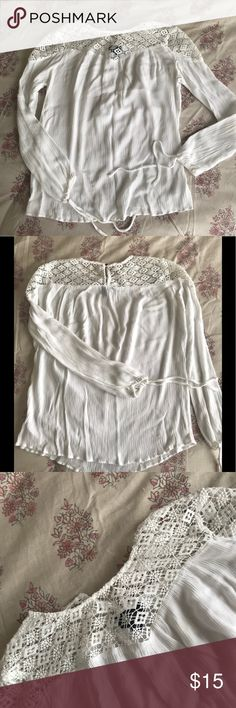 White Lace Top Girly details from lace, to bows, to a button back closure. This shirt is so flirty and fun! Tops Blouses