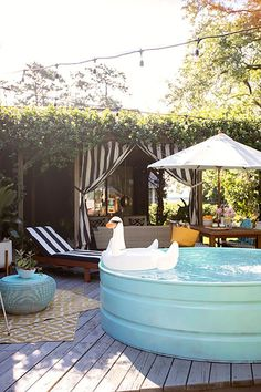 Backyard Oasis with a Stock Tank Pool Stock Pools, Stock Tank Pool, Diy Swimming Pool, Diy Pool, Do It Yourself Pool, Porches, Home Renovation, Backyard Pool Landscaping, Sloped Backyard